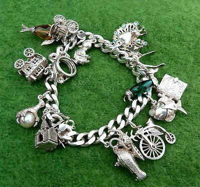 VINTAGE 1970s SILVER CHARM BRACELET WITH 17 SMALL CHARMS ATTACHED - 68.1g