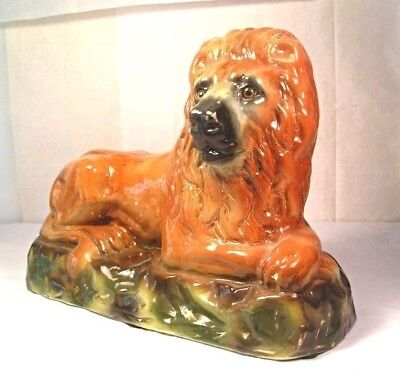 An Antique Staffordshire Pottery Lion with Glass Eyes M22