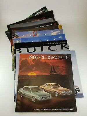 Lot of 28 New Car Dealer Brochures from the 70s 80s 90s and 2000s GM Ford Misc