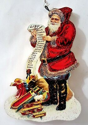 SANTA w/ LONG LIST of NAMES, TOYS * Glitter CHRISTMAS ORNAMENT *Vtg Img