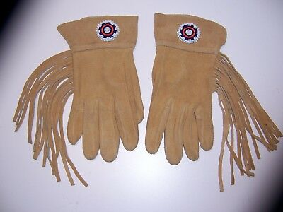 a very nice pair of leather gloves with cuffs,fringe and beaded rosette