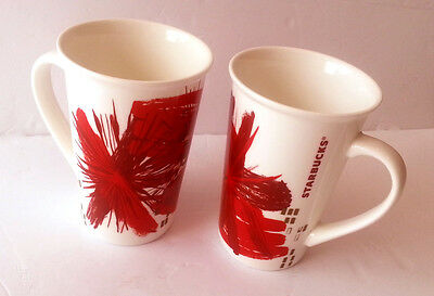 Set of 2 Starbucks Coffee Mugs 12 oz White Red Gold Starburst Christmas Xmas