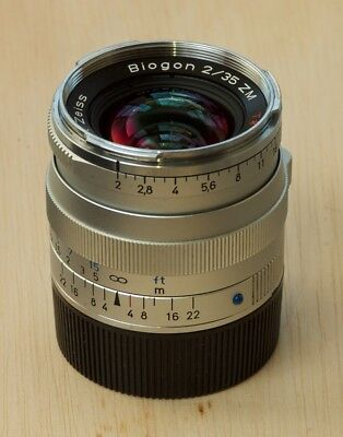 Zeiss Biogon 35 f/2.0 ZM silver with hood, caps, and UV filter