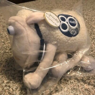 Serta Plush Counting Sheep with blue eyes and blue 80 years emblem.