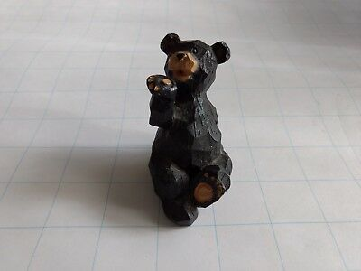 Resin faux-wood carved small bear