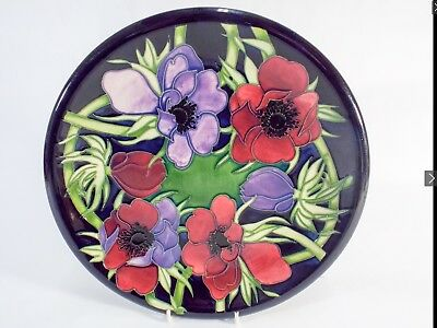 A Moorcroft charger plate decorated with anemones impress marks and dated 2002 t