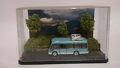 Scenic display with Toyota Coaster bus diecast vehicle