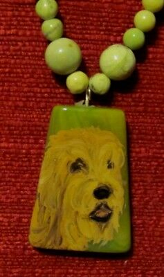 Otterhound hand oaubted ib wedge shaped yellow-green pendant/bead/necklace