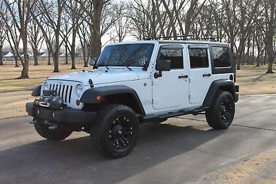 2012 Jeep Wrangler Unlimited Sport 4WD 1 Owner One Owner Perfect Carfax Over $10k in extra's Only 32k Miles Like New Condition