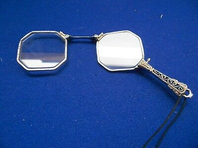 A pair Of Vintage Folding Lorgnette Opera Glasses In Silver With Filigree Detail
