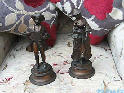 Two Bronze Figurines. Accordian Player And Lady With Flower Basket.