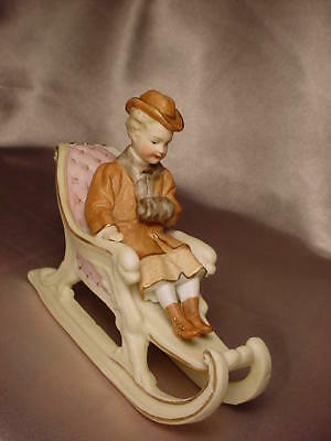 Pair Of Antique Bisque Figures On Victorian Sleighs