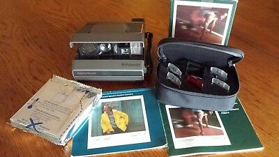 Polaroid Spectra System Camera with Filter set manuals and an Olympic Zoom 2000