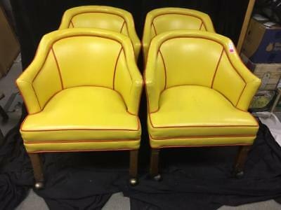 Four rolling yellow leahter arm chairs Lot 173