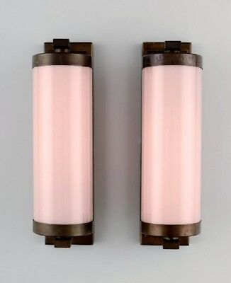 Scandinavian designer, a pair of Art Deco wall lamps in brass
