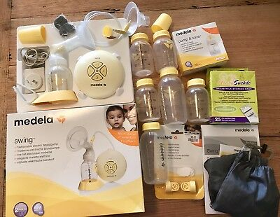 Medela Swing Electric Breast Pump Plus Bottles And Extras