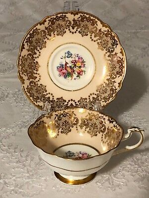 Paragon Double Warrant Cream Gold Cup and Saucer Flowers and Bird