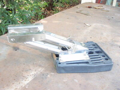 Stainless outboard motor auxiliary spring loaded lift up bracket mount.