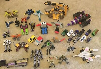 Transformers figurines and cars