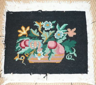 Vintage antique wool needlepoint tapestry flowers black background, damaged