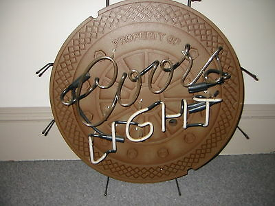 Coors Light  Manhole Cover Back Ground         Neon Sign