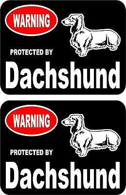 2 protected by Dachshund dog car home window bumper vinyl stickers #B