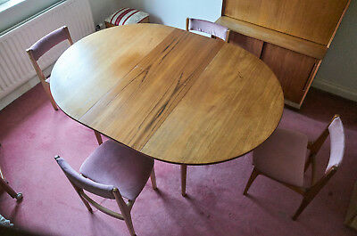 1970's Danish Teak Extending Table and Upholstered Dining Chairs