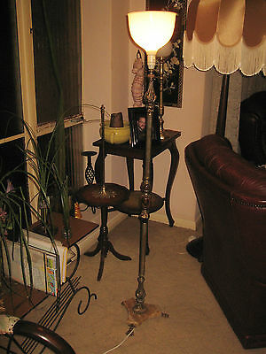 A Brass And Marble Floor Lamp