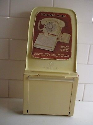 1970's  PHONEAIDE  Ivory incorporates a slide-out Tel. No. Index  PHONEAIDE