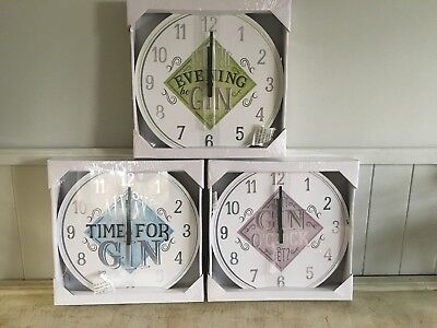 gin time wall mounted clocks  in 3 variations   size 30cm diameter approx