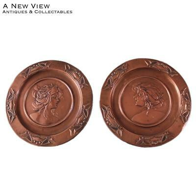 Art nouveau pair of lady maiden wall plaques.