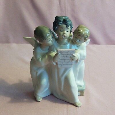 "Lladro Group of Sining Angels, #4542, 6 1/2"" H, Pre owned NO BOX"