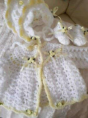 handmade crocheted baby girl cardi bonnet and bootees set