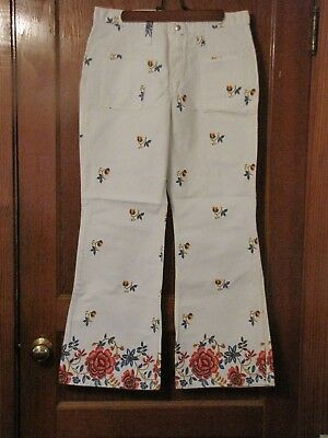 vintage womans jeans wrangler bell bottoms 1070s size 18, white with roses.