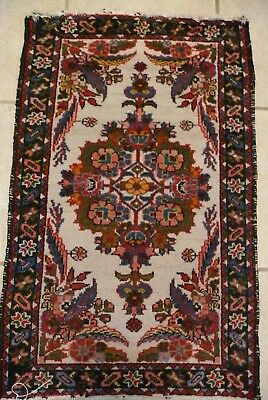 CARPET/RUG FROM THE 1960s; 38 in x 23.5 in.WHITE BACKGROUND; RED/ROSE DESIGN