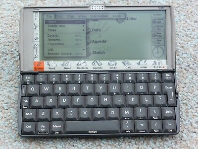 Psion Series 5mx hand held PDA with serial lead and stylus