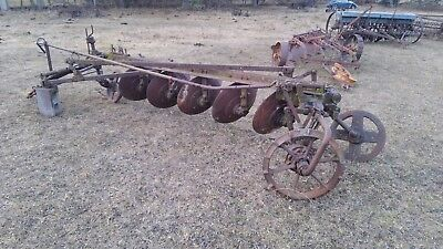 John Deere Steel wheel disk plow