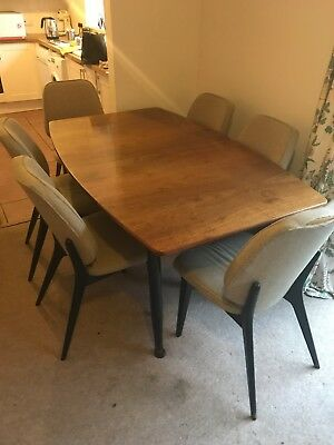 Vintage 1950's extending Rosewood dining table and six original chairs