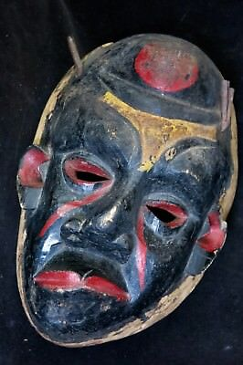 Dramatic Old Ibibio Sickness Mask Contorted With Pigments and Rusty Horns