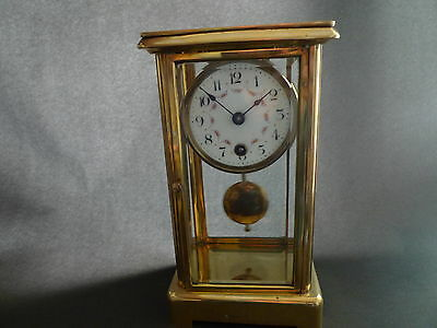 A minature four glass crystal mantel clock