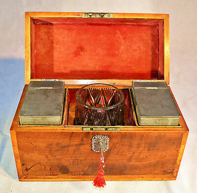 A mid-19th Century Flamed Mahogany Tea Caddy with Glass Mixing Bowl & Key