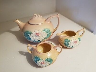 Roseville hull pottery 3 piece tea set has water lilly on front in vintage pink