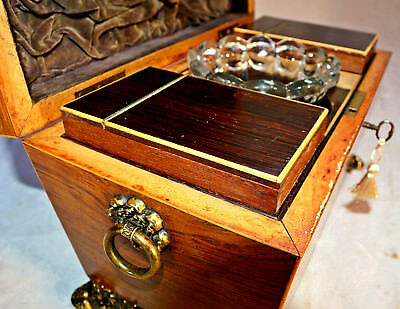 A Regency Sarcophagus Shaped Rosewood Tea Caddy with Mixing Bowl & Key