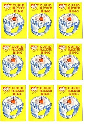 ESZ3273 Vintage Lot of 9 CUPID FLICKER RING Vending Machine Paper Ad Piece 60s~~