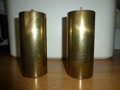 A PAIR OF ANTIQUE BRASS CLOCK WEIGHTS 9cm HIGH AND WEIGHS 2 KILOS