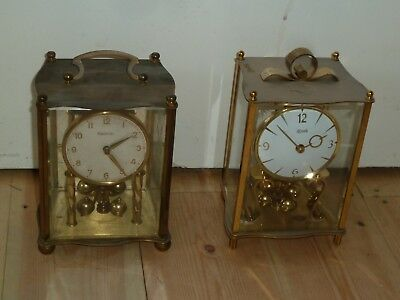 Two vintage glass cased mechanical anniversary clocks for spares