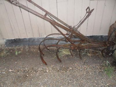 Antique farming Old Horse Drawn Cultivator
