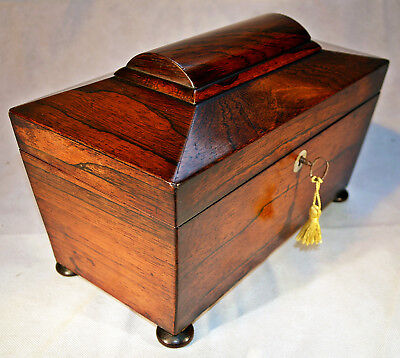 A Victorian Rosewood sarcophagus shaped Tea Caddy with Mixing Bowl & Key