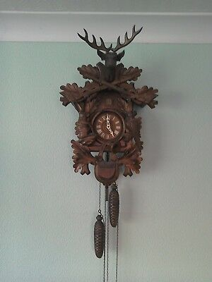 Vintage black forest wooden german cuckoo clock. Good condition