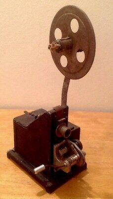 8mm ANTIQUE CINE PROJECTOR WITH HAND CRANK